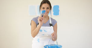 Cute playful young woman with blue paint Stock Images