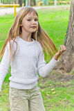 Cute playing girl Stock Images