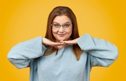 Cute plump woman with hands under chin royalty free stock photography