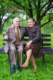 Cute 80 plus year old married couple posing for a portrait in their garden. Love forever concept.  stock photography