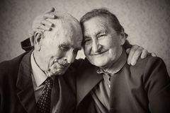 Cute 80 plus year old married couple posing for a. Portrait in their house. Love forever concept royalty free stock photo