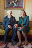Cute 80 plus year old married couple posing for a portrait in their house. Love forever concept royalty free stock image