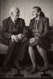 Cute 80 plus year old married couple posing for a portrait in their house. Love forever concept royalty free stock photography
