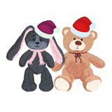 Cute plush toys in Christmas caps Royalty Free Stock Images