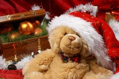 A cute plushy bear as a Christmas gift Royalty Free Stock Photography