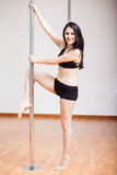 Cute pole fitness student in class Royalty Free Stock Photo