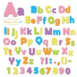 Cute polka dot colored font for kids. Cute polka dot funny font for kids. Letters and numbers Stock Images