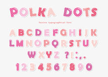 Cute polka dots font in pastel pink. Paper cutout ABC letters and numbers. Funny alphabet for girls. Royalty Free Stock Image