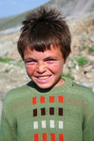 Cute poor boy portrait. While he is smiling Stock Photo
