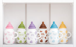 Cute Porcelain Milk Bottles with Colorful Covers Stock Images