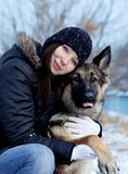 The German Shepherd Dog with Young girl. Lovely portrait. royalty free stock photography
