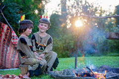 Cute portrait of native american boys with costumes, playing out Royalty Free Stock Photo