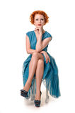 Retro readhead in vintage blue dress Stock Photo