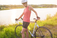 Cute portrait of young serene caucasian female cyclist having a Royalty Free Stock Images
