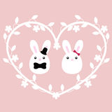 Cute poster for the wedding with a pair of bunnies boy and girl. With floral frame in heart shape. Vector illustration. Pattern to decorate greeting or Stock Image