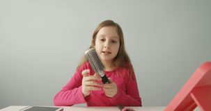 Cute Pre-teen Child Vlogger Recording Video Online for Vlog Channel on Social Media while Brushing her Hair with a Brush Shot on R stock footage