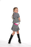 Cute pre teen girl in black and white. Checkered stylish outfit Royalty Free Stock Photo