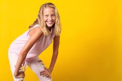 Free Cute Pre-teen Girl Wearing Fashion Summer Clothes Posing On Yellow Background. 10 Years Old Girl With Beauty Eyes, Blonde Hairl Stock Photos - 146904443