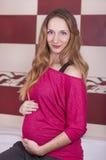 Cute pregnant woman Stock Photos
