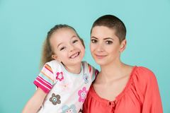 Cute preschool age girl with her mother, young cancer patient in remission. Cancer patient and family support. Cute preschool age girl with her mother, young Stock Images