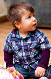 Cute preschool boy. Half body portrait of cute preschool or toddler boy playing with toys at home Royalty Free Stock Photography