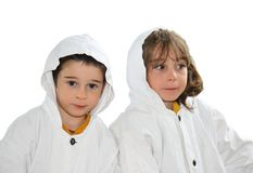 Cute preschool boy and girl in white hooded cloaks Royalty Free Stock Image