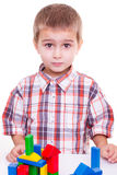 Cute preschool boy play wood block Stock Images