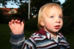 Cute preschool boy waving Royalty Free Stock Photo
