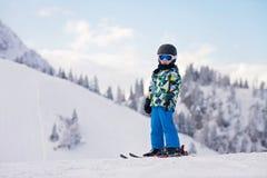Cute preschool child, boy, skiing happily in Austrian ski resort Royalty Free Stock Image