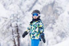 Cute preschool child, boy, skiing happily in Austrian ski resort Stock Image