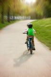 Cute preschool children, riding bikes in the park. Springtime Royalty Free Stock Photos