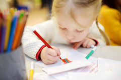 Cute preschooler girl drawing a picture Stock Photo