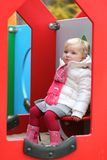 Cute preschooler girl enjoying playground at winter Royalty Free Stock Images