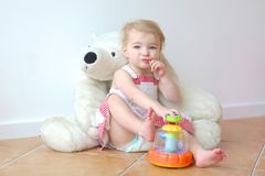 Cute preschooler girl playing games with her toys Stock Photos