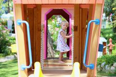 Cute preschooler girl playing outdoors in the park Stock Image