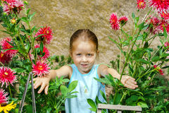 Cute preschooler girl portrait with natural flowers Royalty Free Stock Photos