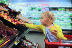 Cute preschooler girl in shopping cart Stock Photos