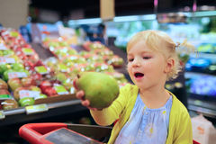 Cute preschooler girl in shopping cart Stock Images