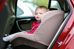 Cute preschooler girl sitting in the car Stock Images