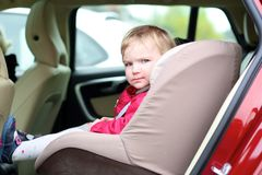 Cute preschooler girl sitting in the car Royalty Free Stock Photos