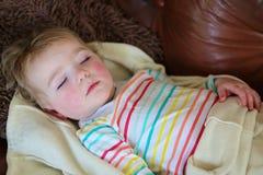 Cute preschooler girl sleeping on sofa Royalty Free Stock Images