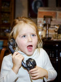 Cute preschooler girl talking by old vintage retro telephon. Closeup portrait royalty free stock images