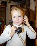 Cute preschooler girl talking by old vintage retro telephon. Closeup portrait royalty free stock image