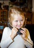 Cute preschooler girl talking by old vintage retro telephon. Closeup portrait stock photos