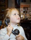 Cute preschooler girl talking by old vintage retro telephon. Closeup portrait stock images