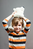 Cute Preschooler having fun with his stuffed Toy Royalty Free Stock Image