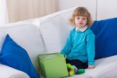 Cute preschooler on the sofa Royalty Free Stock Photography