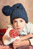 Cute preteen boy in blue knitted hat Stock Photo