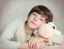 Cute preteen boy with ship  toy Stock Images