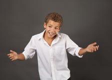Cute Preteen Boy Shrugging Stock Photos
